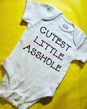 "Load image into Gallery viewer, ""Cutest Little Asshole"" baby grow"