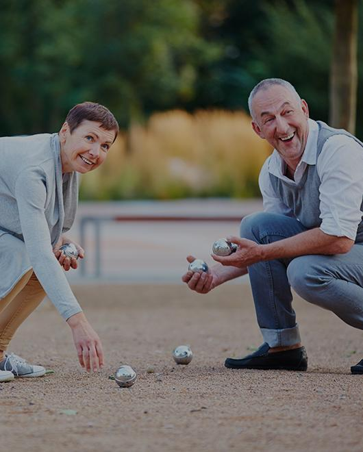 senior couple playing bocce ball