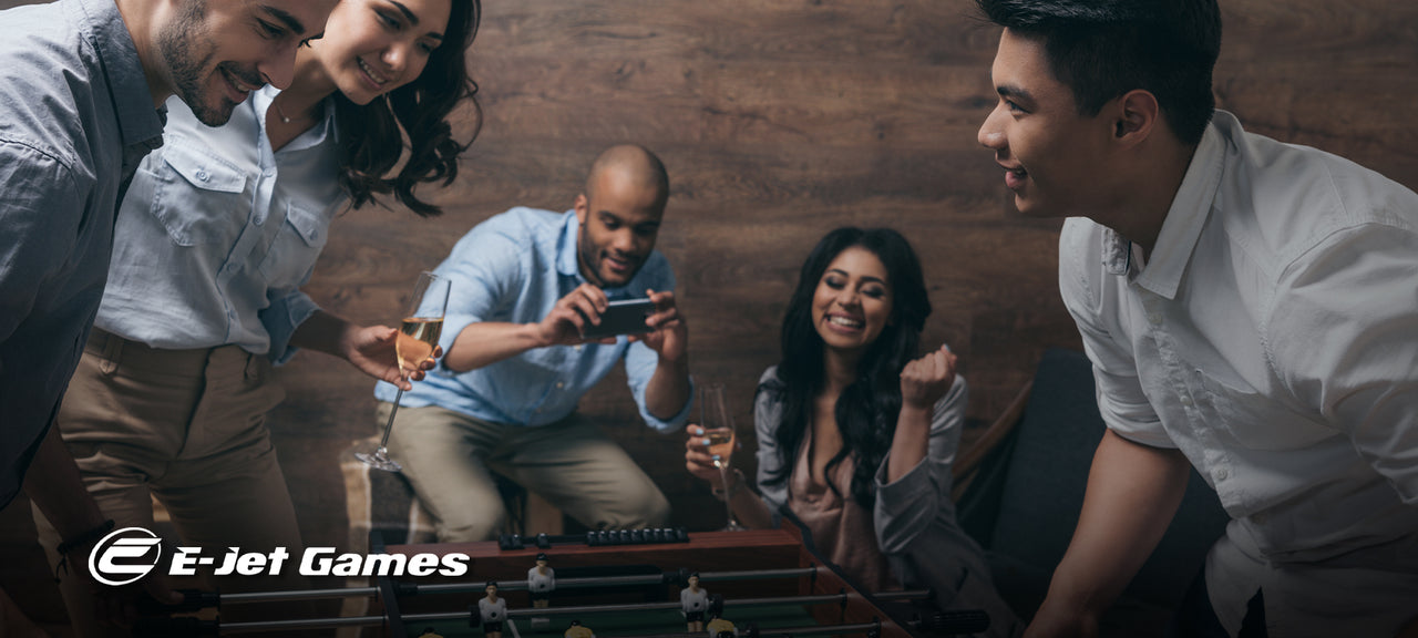 Group of young adults playing foosball