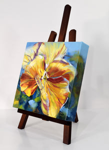 Sunny Petunia original oil painting on display easel facing left by Pat Cross.