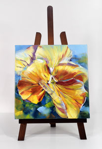 Sunny Petunia original oil painting on display easel by Pat Cross.