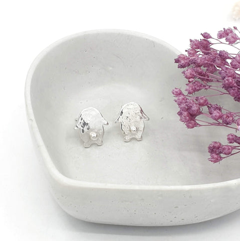 hammmered texture silver earrings of a rabbit with 3d silver tail