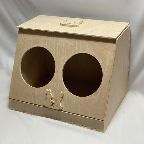 Wooden hay feeder with two holes on front side for rabbits to access hay. Raised logo on top flap and on front middle.