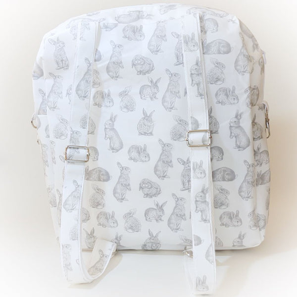 Rear view of backpack with grey bunny design on white bag, showing adjustable straps