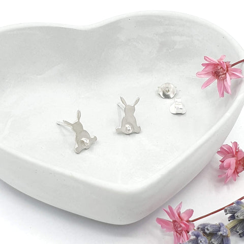 Silver earrings of rabbits from behind with 3D tail detail