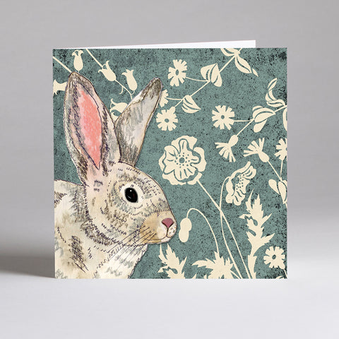 Square greetings card with a picture of a wildwood rabbit and flowers on it