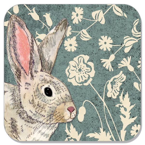 Square coaster with a picture of a wildwood rabbit and flowers on it