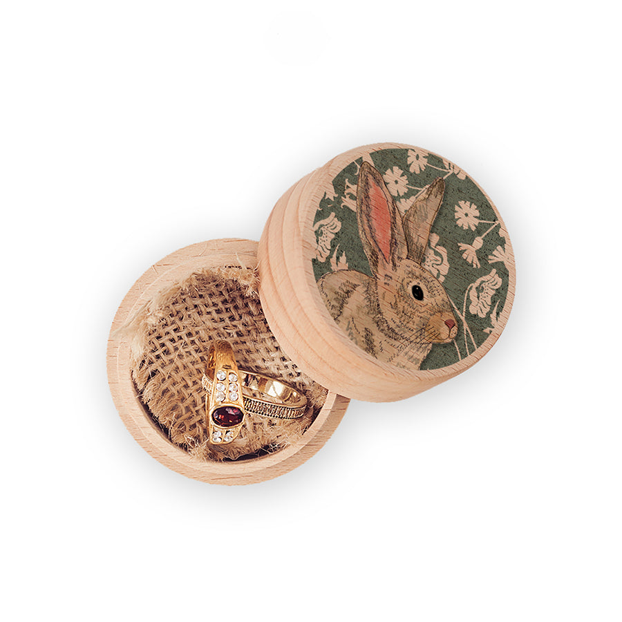 Small wooden circular trinket box with a picture of a wildwood rabbit and flowers on top