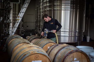 Hattingley Valley Apprentice Andy Wiles In The Winery With Barrel
