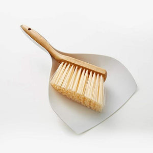 Space saving dustpan and brush set