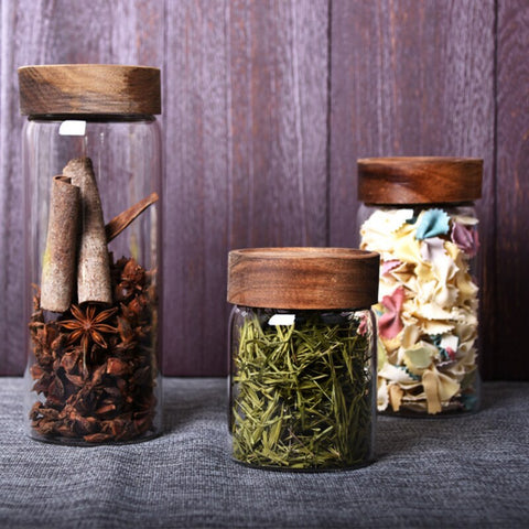 Glass kitchen storage jars with wooden lids