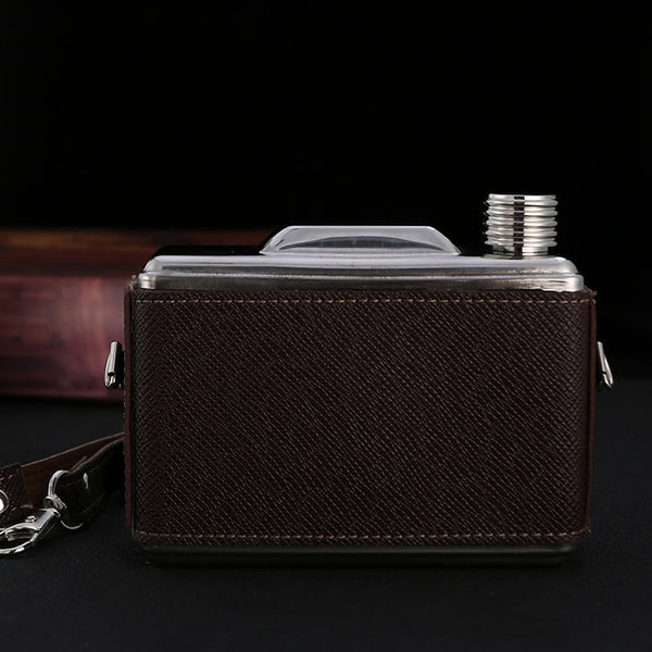 Vintage stainless steel camera hip flask