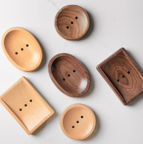 Natural light and dark wooden soap dishes
