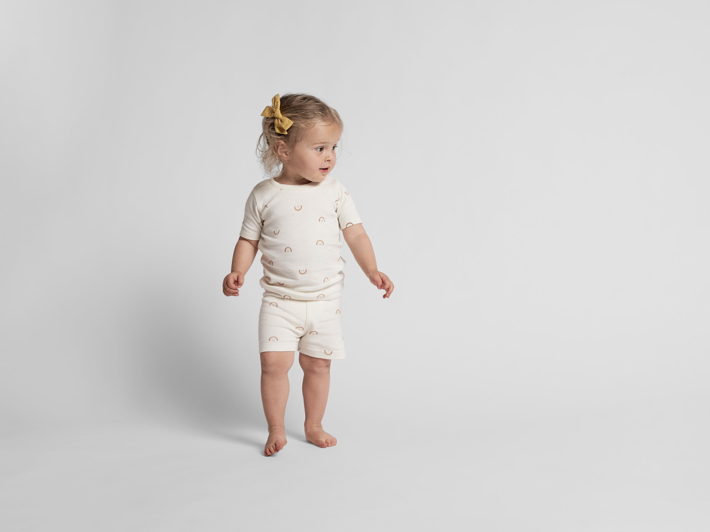 White Rainbow Pajama Set Shown In A Room