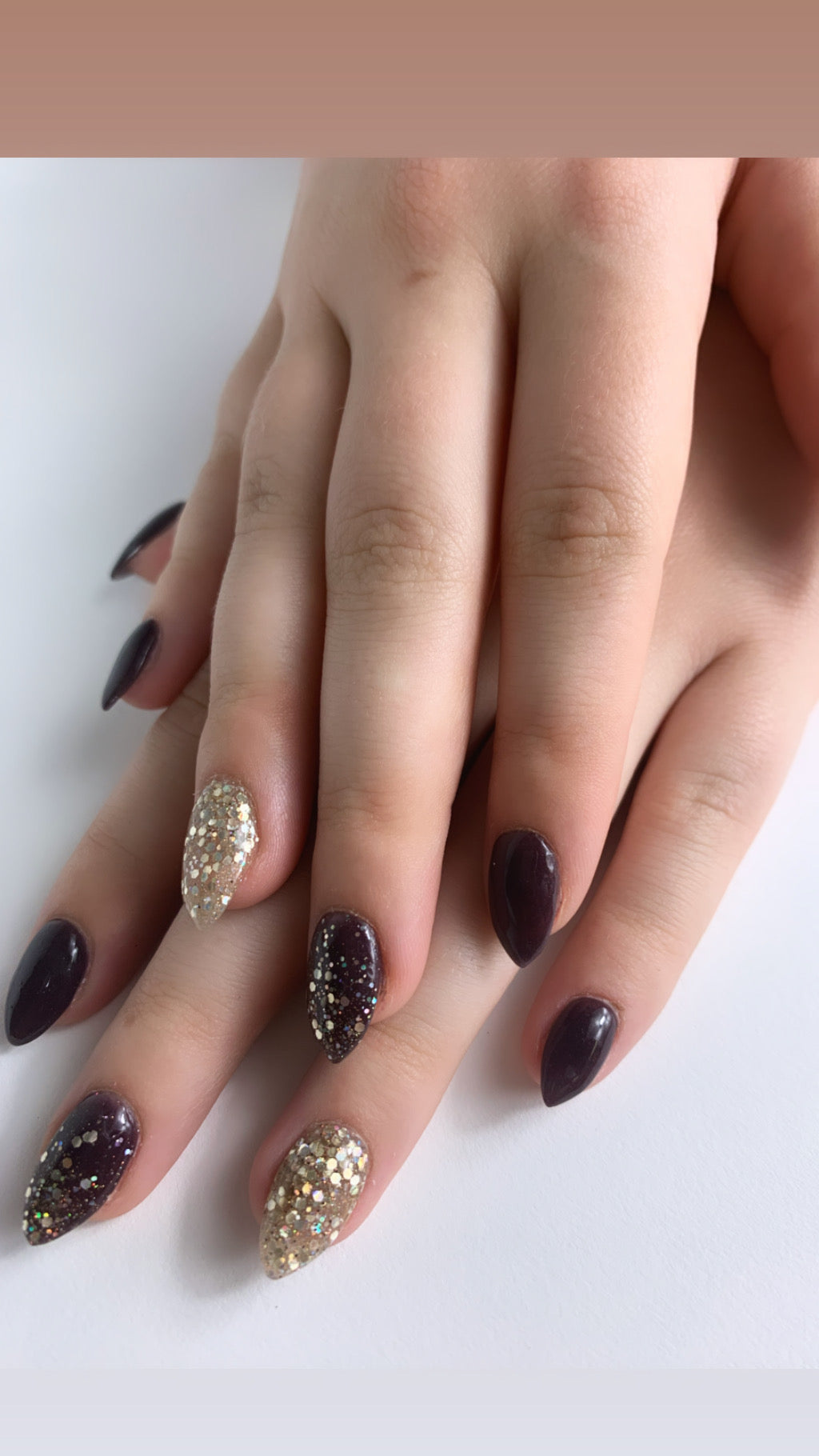 Photo of Cadence and Glitz dip powder manicure