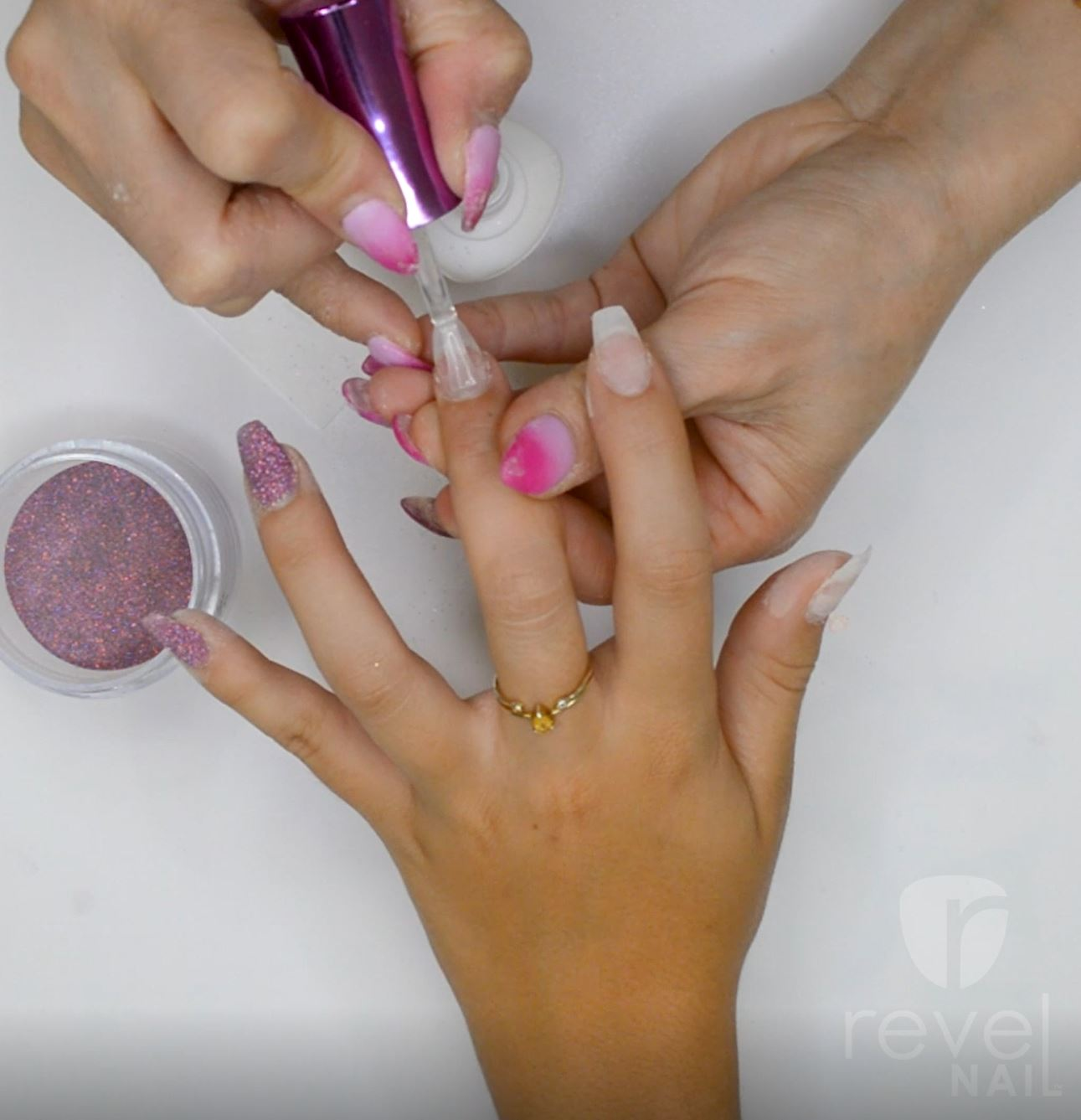 Photo of nail tech Applying Probase/revel nail dip powder