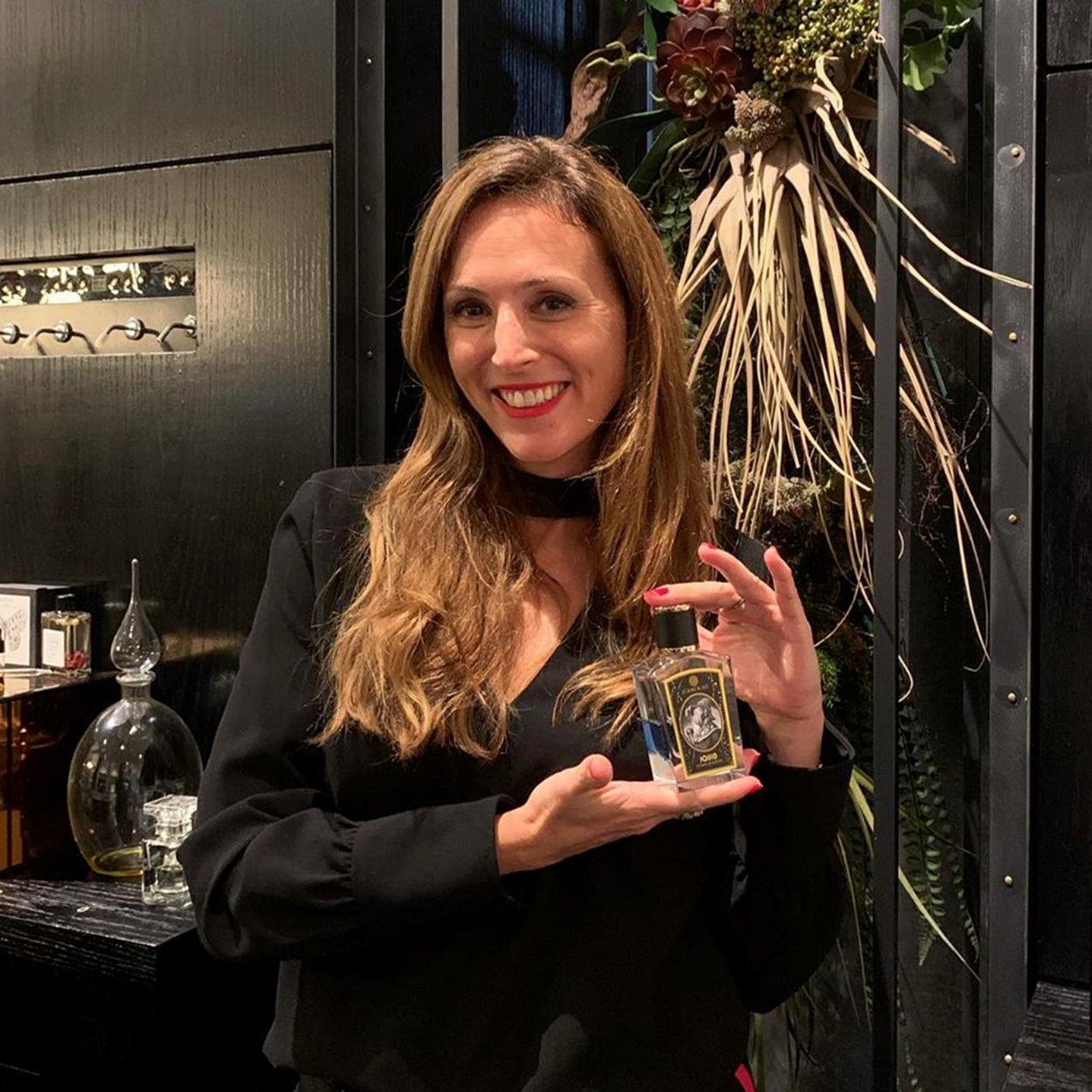 Celine Barel Holding Bottle of Zoologist Squid