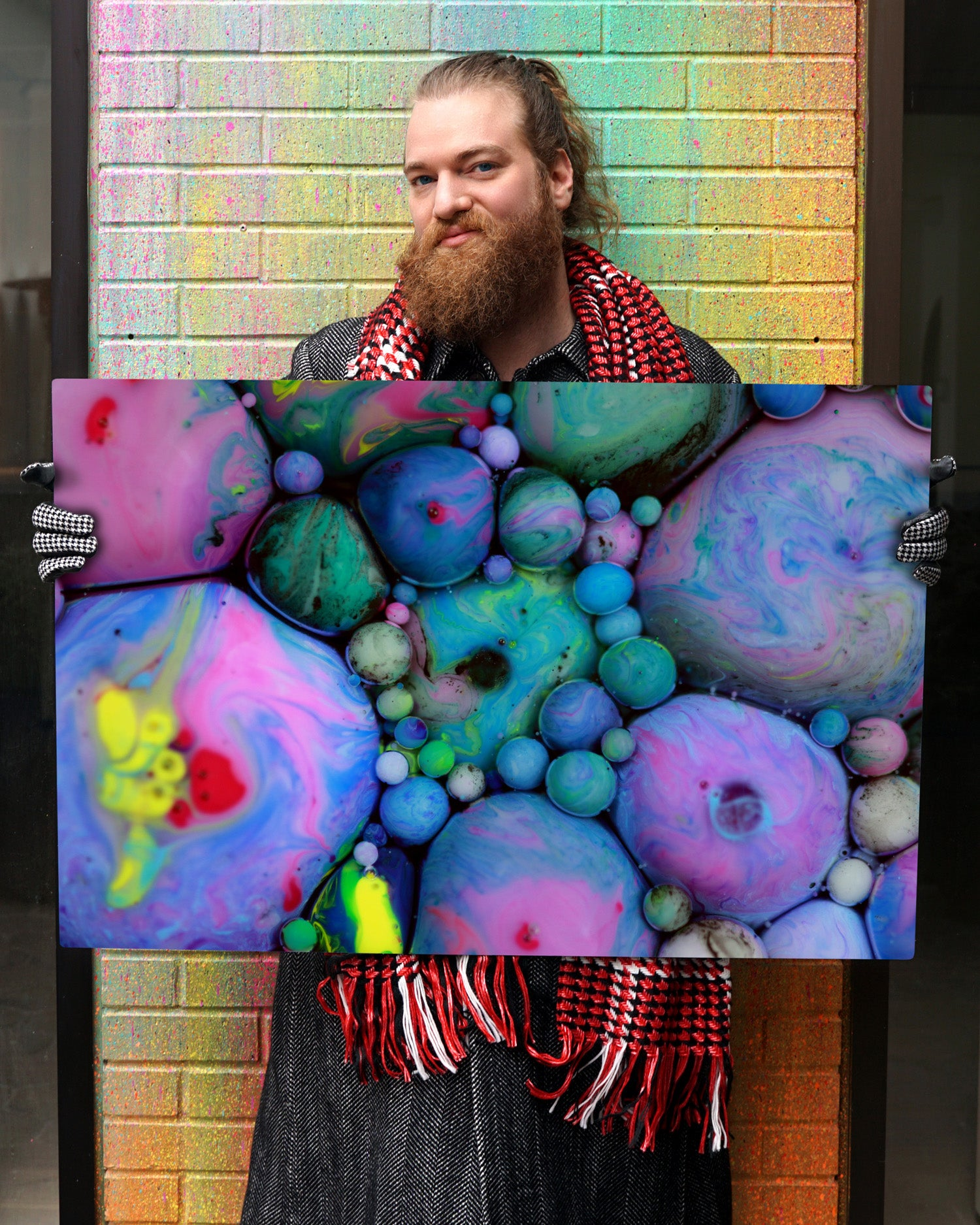 "Seb Duke, ""The Big in the Small"", holding art photo, ""The Truth Emerges"""