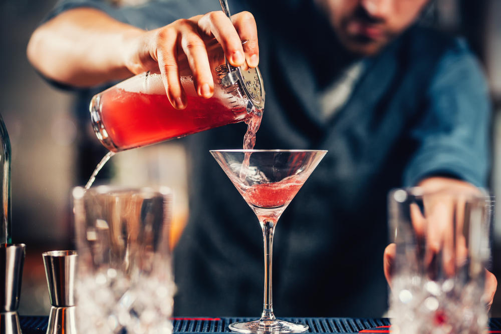 Man serving Hibiscus Martini