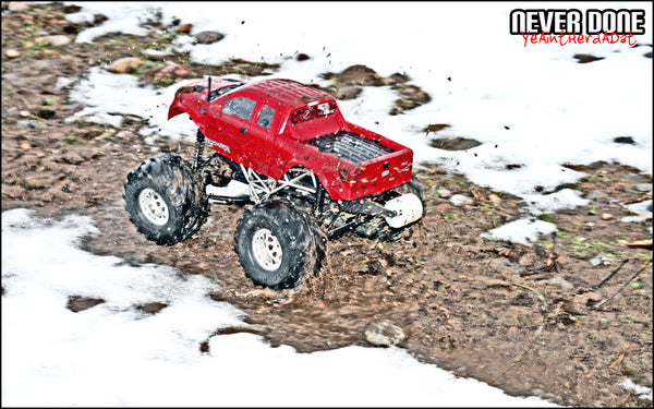 RC Truck in the mud HPI Wheely King
