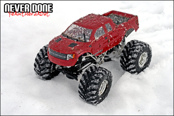 Custom HPI Wheely King with 1/10th scale Raptor body in the snow
