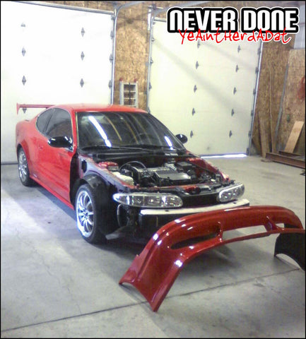 Red Never Done Alero in shop with brand new bumper