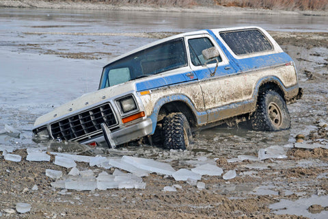 Never Done Bronco off road in ice water
