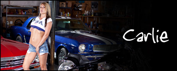 Never Done Girl Carlie in a blue bra with a 1967 Chevelle and 1965 Mustang