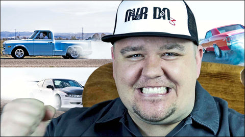 Clint Grover with cars and trucks doing burnouts in the background