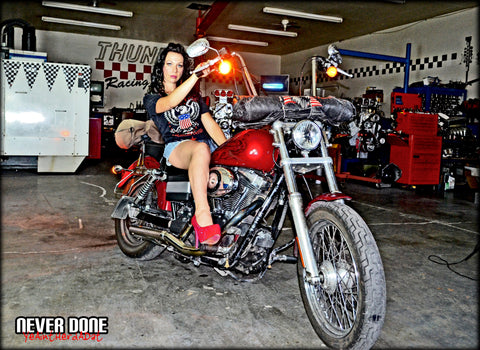 Never Done Girl Sharlie on a custom Harley with ape hangers