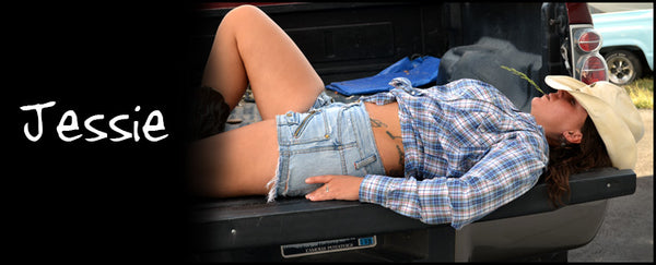 Never Done Girl Jessie on the tailgate of a 2005 Ford Super Duty F350 V10