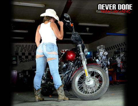 Never Done Girl Jessie showing off her cowgirl ass with a custom Harley Davidson