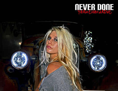 Never Done Girl Belinda in front of a rat rod with custom halo headlights