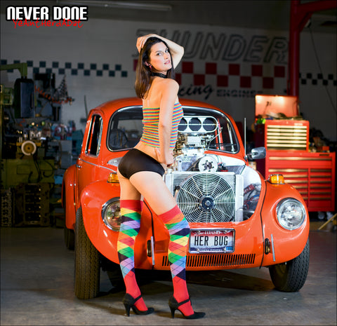 Never Done Girl Skyler in knee high socks with a front engine VW Bug Hot Rod supercharged chevy small block