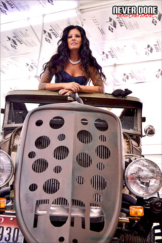 Tattooed model Never Done Girl Tasia with a custom rat rod