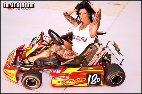 Never Done Girl tattooed in a wife beater on a fast go kart
