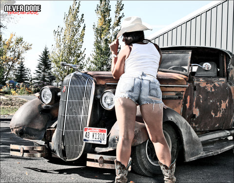 Never Done Girl Jessie showing off her ass with a 1938 Buick Rat Rod