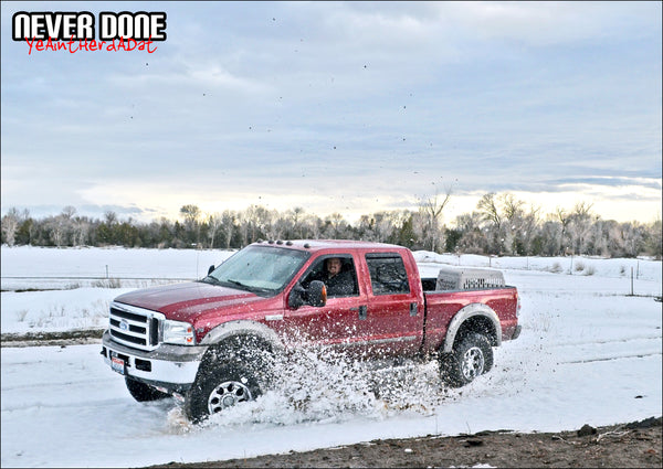 Clint Grover 2005 Ford F350 off road in the snow spinning cookies