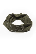 "Load image into Gallery viewer, Get Up Stand Up Multi Use Headband/Face Mask by Alexandra Velasco in Olive Green - Nude Woman Print with text ""La suavidad de la luna. La fuerza del sol."" - rolled like neck gaiter"