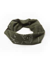 "Get Up Stand Up Multi Use Headband/Face Mask by Alexandra Velasco in Olive Green - Nude Woman Print with text ""La suavidad de la luna. La fuerza del sol."" - rolled like neck gaiter"