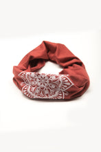 Load image into Gallery viewer, Eye See You by Melody Tunks - brick red fabric with white ink - mandala design - rolled like neck gaiter