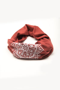 Eye See You by Melody Tunks - brick red fabric with white ink - mandala design - rolled like neck gaiter