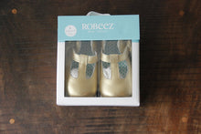 Load image into Gallery viewer, Robeez gold t-strap soft shoes sz 9-12M (NIB $38)