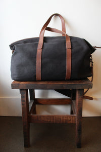 NISOLO WEEKENDER DUFFLE BAG IN BLACK (few spots on bottom) ($200 ONLINE)