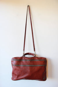 INSTINCT RED LEATHER SOFT BRIEFCASE WITH CROSSBODY STRAP