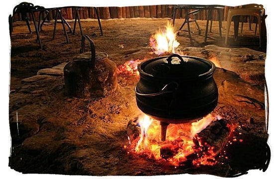 Eating African Food By Fireside
