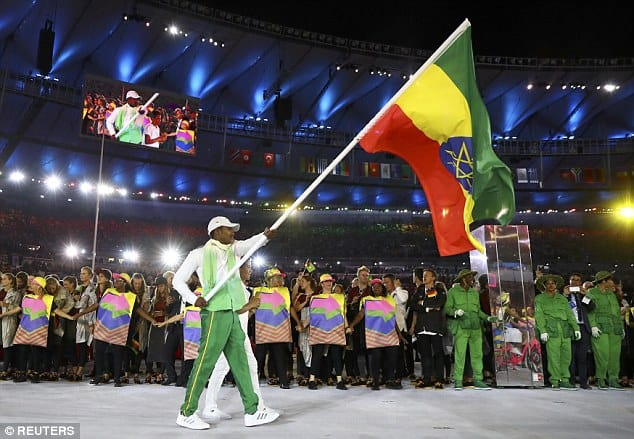 Swimming - Ethiopian Robel Kiros Habte Waving the Flag