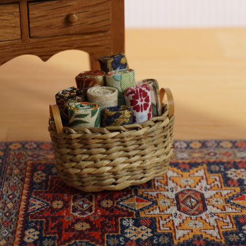Basket of Assorted Fabric Rolls
