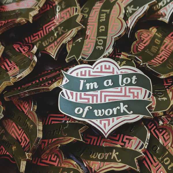 A Lot of Work (olive/cantaloupe version) hard enamel pin – SECONDS