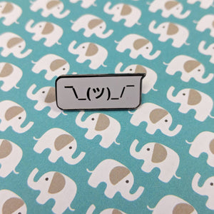 Shrug hard enamel pin
